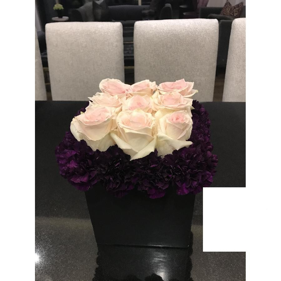 Light Pink Roses Bordered With Carnations In A Black Vase