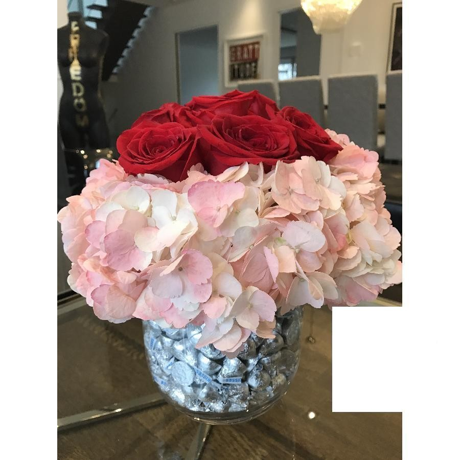 Red Roses With Pink Hydrangeas In A Double Barrel Glass Vase Filled With Hershey Kisses